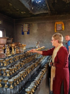 Judy lighting butter lamps, 2014